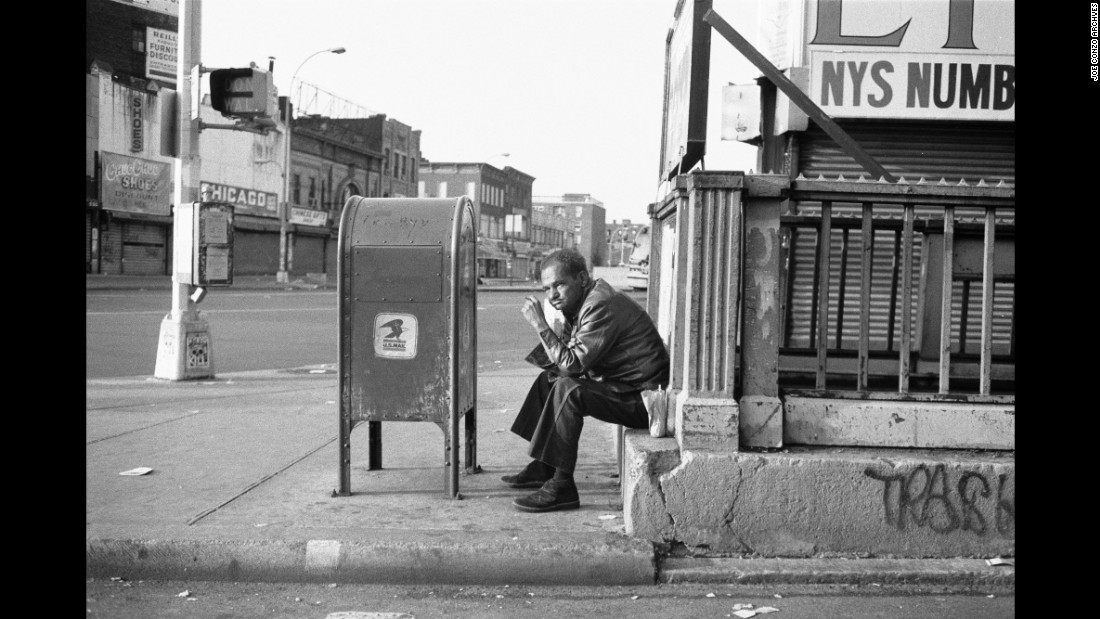 A man sits on a stoop at Third Avenue and 149th Street.