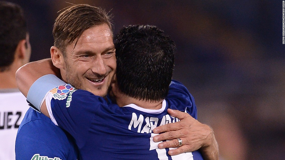 Totti (left) confessed after the game that he can now retire happy having played with Maradona. The Roma veteran was assisted by Maradona for his first half goal.