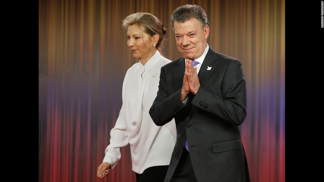 "Colombian President Juan Manuel Santos, right, arrives with his wife for a press conference at the presidential palace in Bogota, Colombia, on Friday, October 7. <a href=""http://www.cnn.com/2016/10/07/world/nobel-peace-prize-2016/index.html"" target=""_blank"">Santos won the Nobel Peace Prize</a> five days after <a href=""http://edition.cnn.com/2016/10/02/americas/colombia-farc-peace-deal-vote/"" target=""_blank"">Colombian voters narrowly rejected a peace deal</a> aimed at ending their country's 52-year-long civil war with the FARC rebel group."