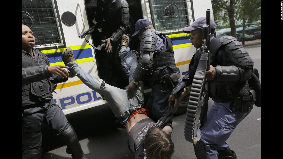 "A student from Wits University is arrested after clashes with police in Johannesburg on Monday, October 10. For more than a year, students across South Africa have been <a href=""http://www.cnn.com/2016/10/11/africa/south-africa-student-protests/index.html"" target=""_blank"">protesting against university fee increases</a>."