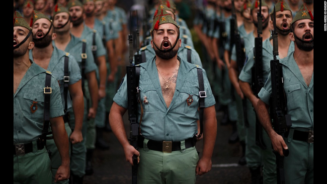 Members of La Legion, an elite unit of the Spanish Army, sing during a Hispanic Day celebration in Madrid on Wednesday, October 12.