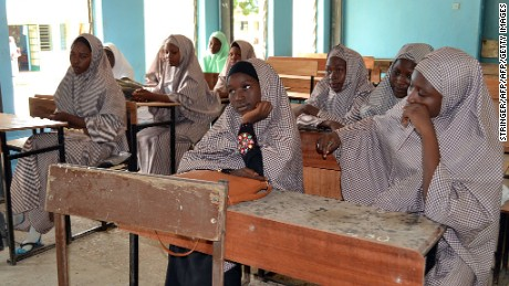 Female students of government college listen to a lecture in a classroom following the re-opening ceremony of public schools in Maiduguri, northeast Nigeria, on October 10, 2016. Students from public school in northeast Nigeria, from where more than 200 girls were kidnapped by Boko Haram, have resumed lessons, more than two years after the mass abduction. Chibok became synonymous with the Boko Haram conflict when fighters abducted 276 girls from the Government Secondary School (GSS) on the evening of April 14, 2014, sparking global outrage. / AFP / STRINGER        (Photo credit should read STRINGER/AFP/Getty Images)