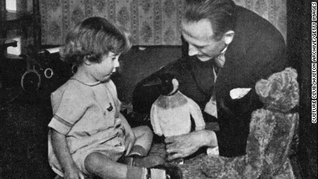 A.A. Milne and son playing with the toy that inspired the new character.