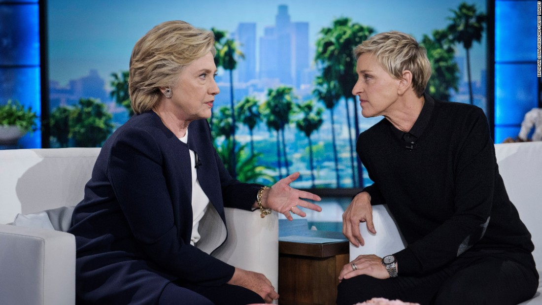 "Democratic presidential nominee Hillary Clinton, left, talks with television host Ellen DeGeneres during a commercial break on ""The Ellen DeGeneres Show"" in Burbank, California, on Thursday, October 13."