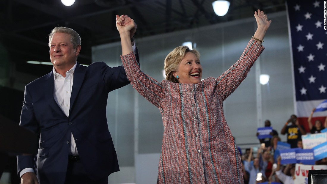 "Democratic presidential nominee Hillary Clinton, right, attends a campaign rally with former Vice President Al Gore in Miami on Tuesday, October 11. The two focused on <a href=""http://www.cnn.com/2016/10/11/politics/hillary-clinton-al-gore-climate-change-2016-election/"" target=""_blank"">climate change</a>, with Gore assuring the crowd that Clinton ""will make solving the climate crisis a top national priority."""