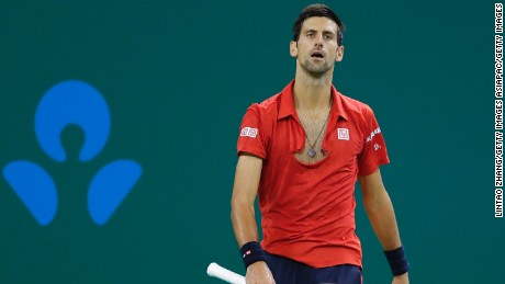 Novak Djokovic tore his shirt in anger after losing a point in his semifinal defeat to Roberto Bautista Agut.