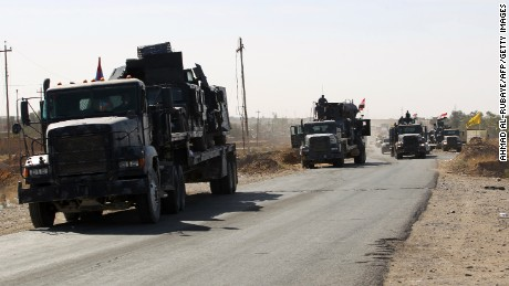 Iraqi forces gather at the Qayyarah military base, about 35 miles south of Mosul, on October 16, as they prepare for an offensive to retake Mosul, the last IS-held city in the country, after regaining much of the territory the jihadists seized in 2014 and 2015.