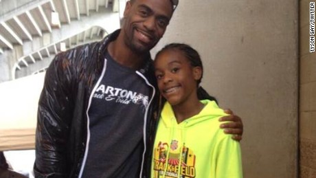 Tyson Gay poses with daughter Trinity in a photo he posted to his Twitter account in 2013.