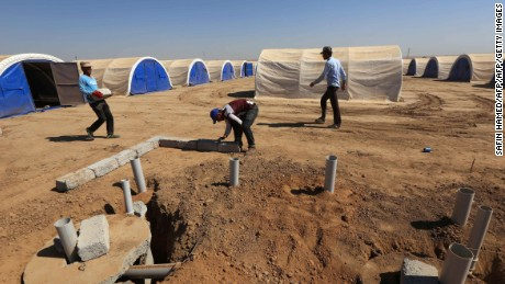 Workers build shelters to house civilians expected to flee the violence.