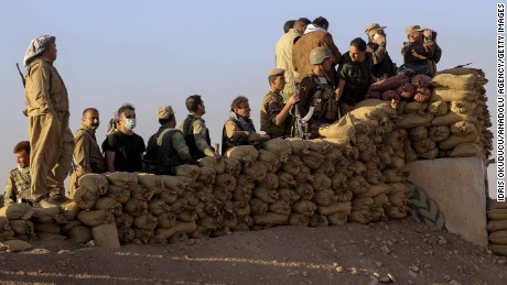 Peshmerga forces stand guard at Kargali village during an operation to liberate Mosul.