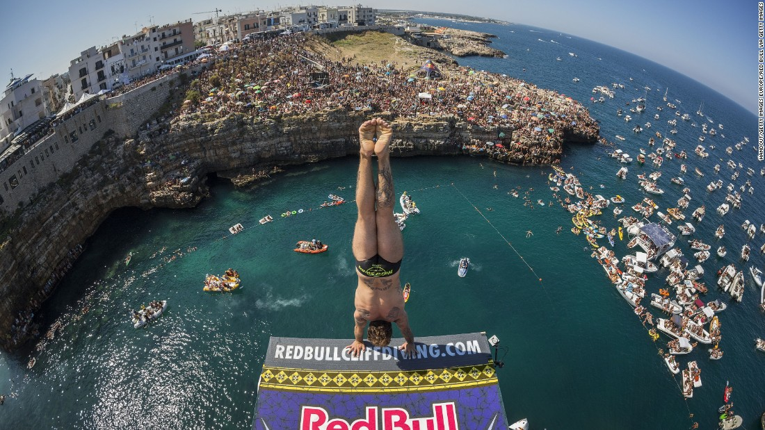 Alessandro de Rose prepares an armstand dive from the 27-meter platform during August's event. The Italian wildcard entry finished fourth, as Russia's Artem Silchenko ended Hunt's winning run.