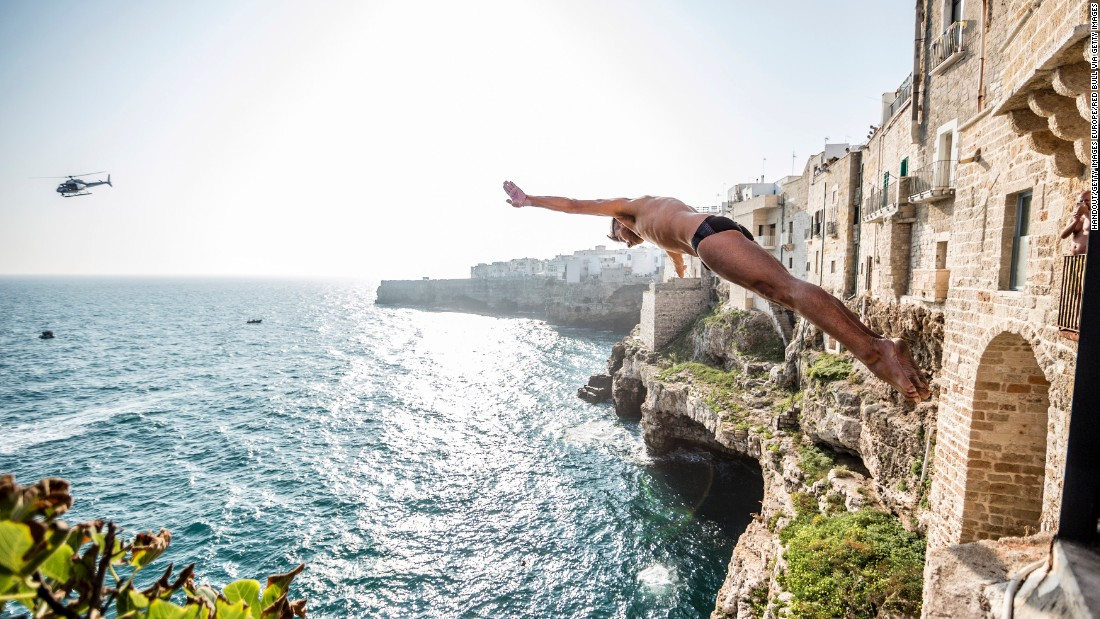 Mexican diver Jonathan Paredes, who finished third, launches himself from the city walls.