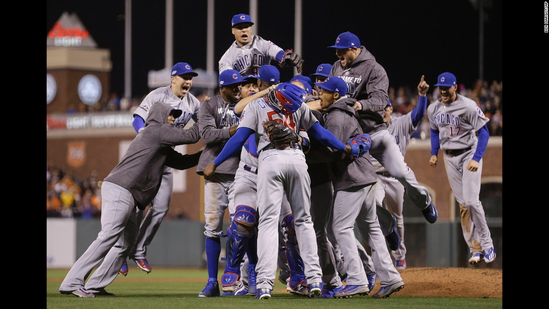 The Chicago Cubs celebrate around pitcher Aroldis Chapman after closing out their playoff series in San Francisco on Tuesday, October 11.