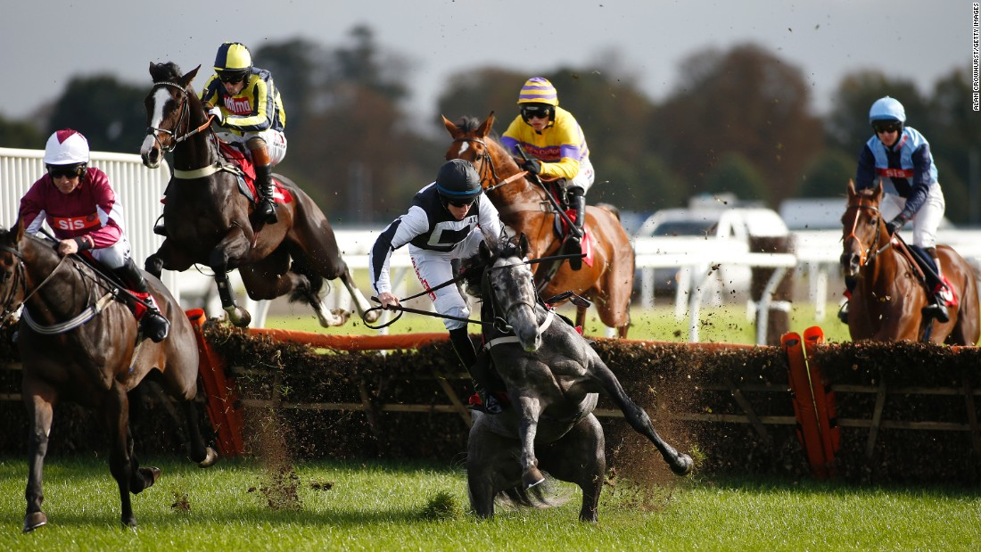 Gavin Sheehan and his horse, Masterson, fall during a hurdles race in Sunbury, England, on Sunday, October 16.