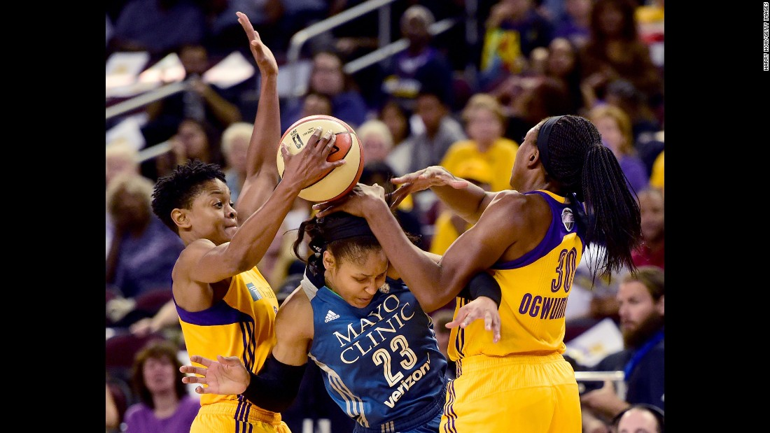 Minnesota forward Maya Moore is trapped by Los Angeles' Alana Beard, left, and Nneka Ogwumike during Game 3 of the WNBA Finals on Friday, October 14. The series is tied 2-2 going into the final game on Thursday.