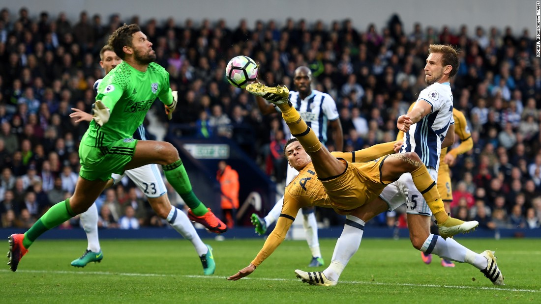 Tottenham's Dele Alli tries to shoot past West Brom goalkeeper Ben Foster during a Premier League match in West Bromwich, England, on Saturday, October 15.