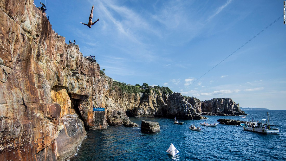 Jonathan Paredes dives off a cliff in Shirahima, Japan, on Saturday, October 15. It was the eighth stop of the Red Bull Cliff Diving World Series.
