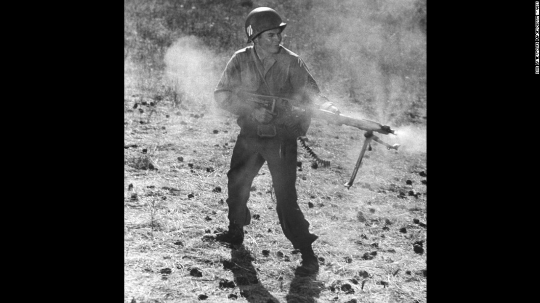 "Actor Audie Murphy, the most decorated soldier in World War II, performing in a scene from the movie ""To Hell and Back."" White men with guns were the American heroes often taught in school."