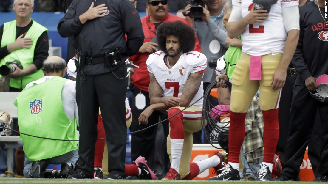 San Francisco 49ers quarterback Colin Kaepernick kneels during the national anthem before an NFL football game. Kaepernick's stand was described by many as unpatriotic, but some say dissent is one of the highest forms of patriotism.