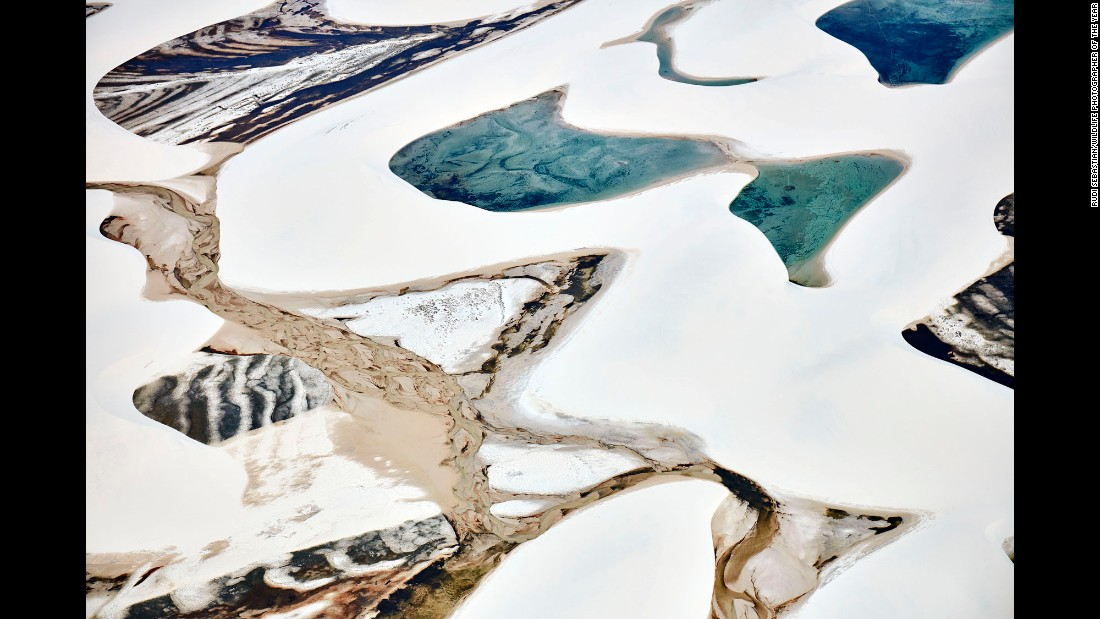 Category: Details<br />The pristine white sand of Brazil's Lençóis Maranhenses National Park offers a blank canvas to natural processes of rain, bacteria, streams, and evaporation that leave behind elegant patterns in the dunes, which can tower to 40 meters (130 feet) high.