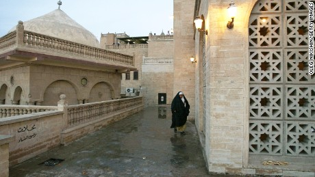 An Iraqi woman walks near the mosque of the Prophet Usuf in October 2002.