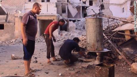 Aleppo residents use an old boiler to make fuel out of plastic.