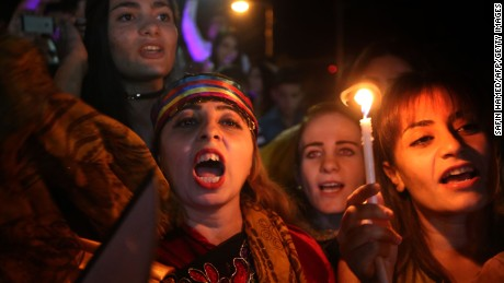 Iraqi Christians celebrate Tuesday in Irbil after Iraqi forces entered their hometown of Qaraqosh.