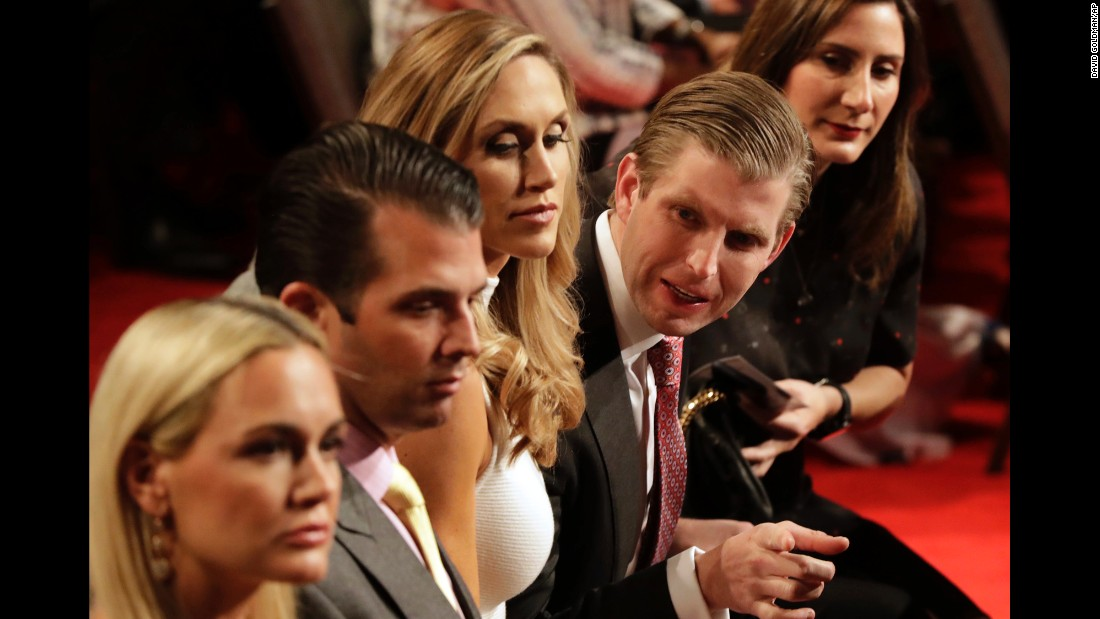 Trump's sons Eric and Donald Jr. wait for the debate to begin.