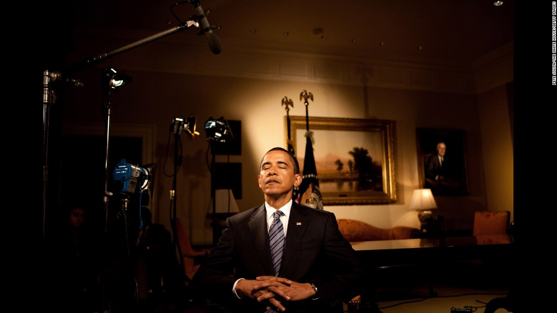 Obama closes his eyes before taping his weekly radio address at the White House on June 2, 2009.