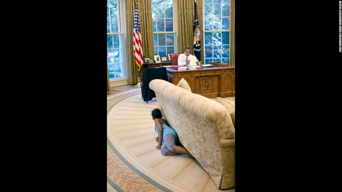 "Sasha Obama hides behind an Oval Office sofa as she sneaks up on her father on August 5, 2009. Sasha was 7 when her father took office. Malia was 10. <a href=""http://www.cnn.com/2012/09/05/politics/gallery/sasha-and-malia-2008-present/index.html"" target=""_blank"">See more pictures of Malia and Sasha Obama since their father was elected President</a>"