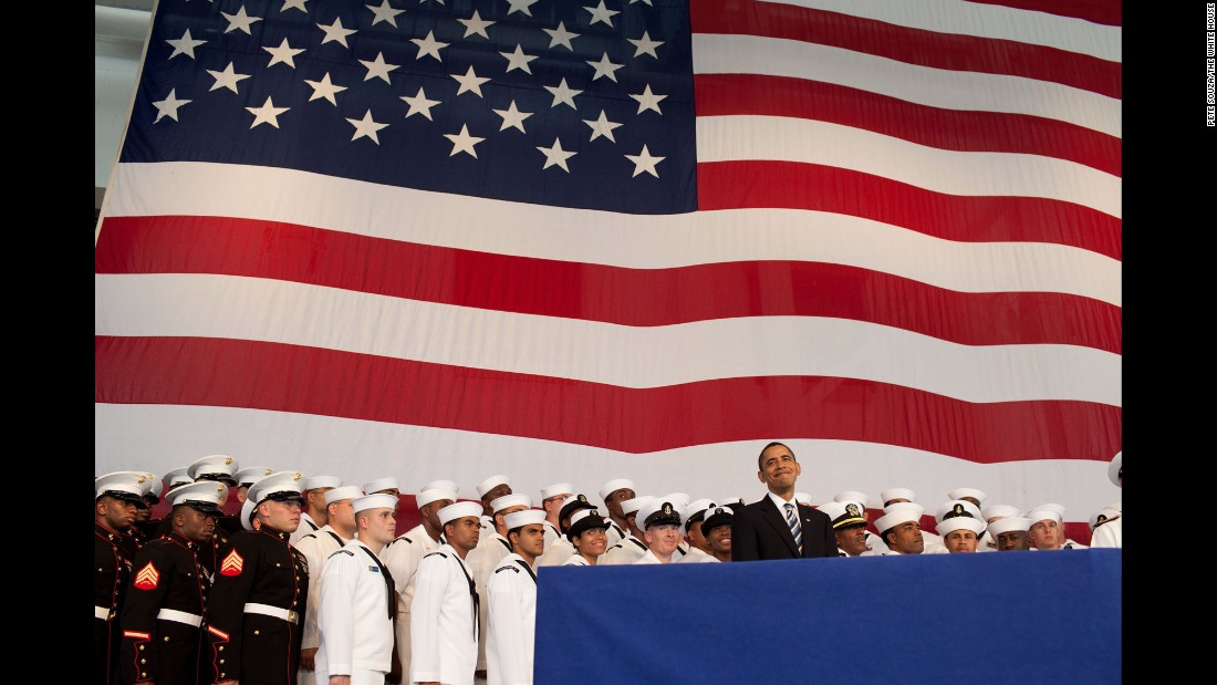 "Obama stands on stage before delivering remarks to service members in Jacksonville, Florida, on October 26, 2009. ""Of all the privileges I have as President, I have no greater honor than serving as your commander in chief,"" Obama said in his speech."