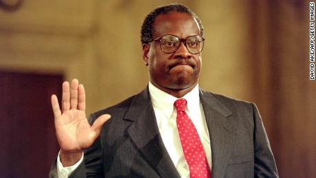US Supreme Court nominee Clarence Thomas raises his right hand as he is sworn in on Sept. 10, 1991, during confirmation hearings before the US Senate Judiciary Committee, a Washington, DC.