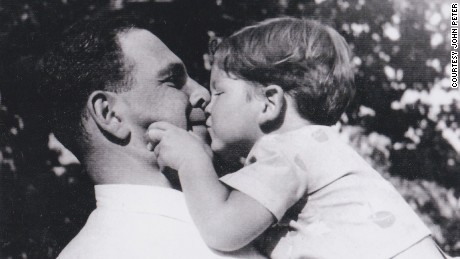 John with his father just before World War II. His father was was killed in 1944 by Hungarian Nazis when John was 6.