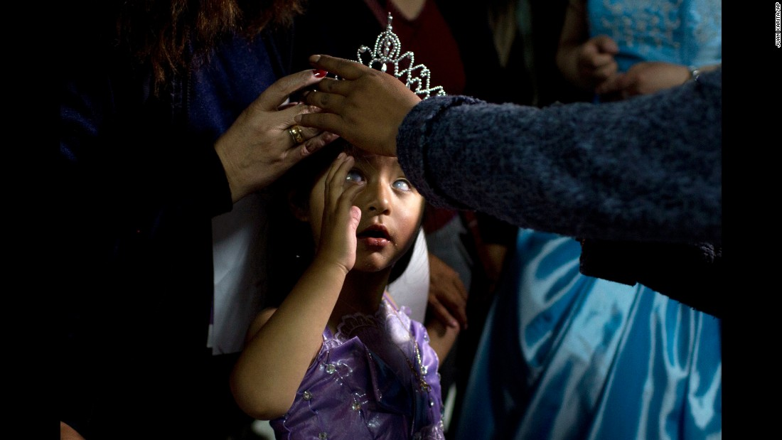 "Mariela Flores, who is visually impaired, is crowned one of two Miss Jacha Uru (""Great Day"") during a pageant in La Paz, Bolivia, on Friday, October 14. The pageant was organized by the families of people with disabilities."