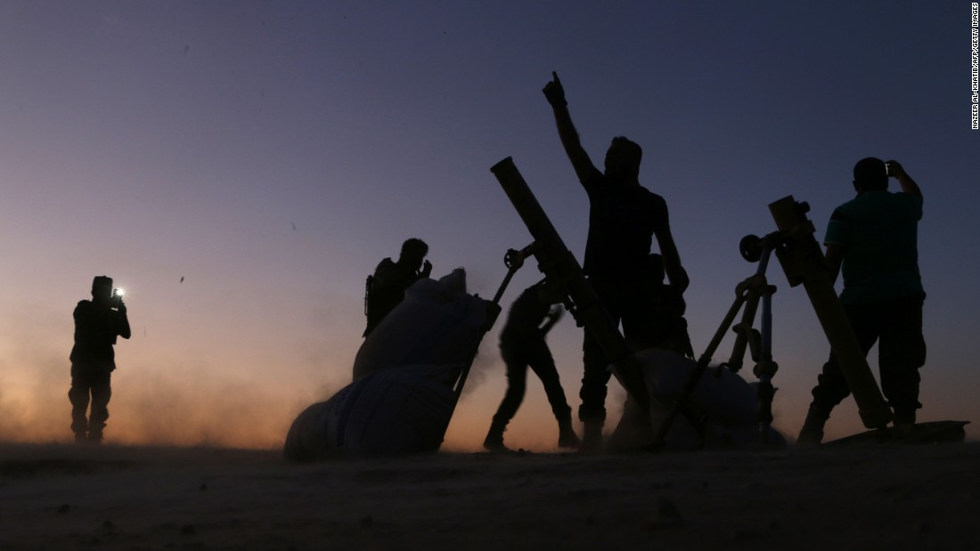 Fighters from the Free Syrian Army cheer as they battle ISIS on the outskirts of Dabiq, Syria, on Saturday, October 15.
