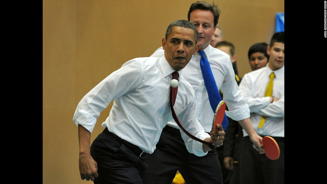 Obama and British Prime Minister David Cameron play table tennis with students in London on May 24, 2011.