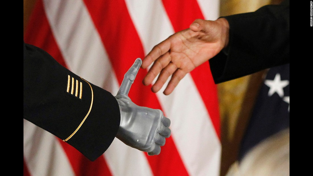 "Obama shakes the prosthetic hand of Army Sgt. 1st Class Leroy Arthur Petry on July 12, 2011. Petry was at the White House <a href=""http://www.cnn.com/2011/POLITICS/07/12/medal.of.honor/"" target=""_blank"">to receive the Medal of Honor.</a> The Army Ranger lost his hand while tossing an enemy grenade away from fellow soldiers in Afghanistan."