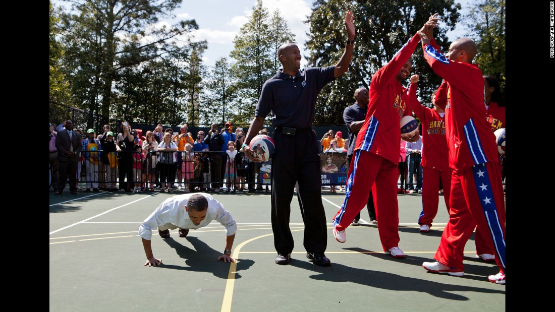 Obama does pushups on the White House basketball court after a member of the Harlem Globetrotters made a shot on April 9, 2012.