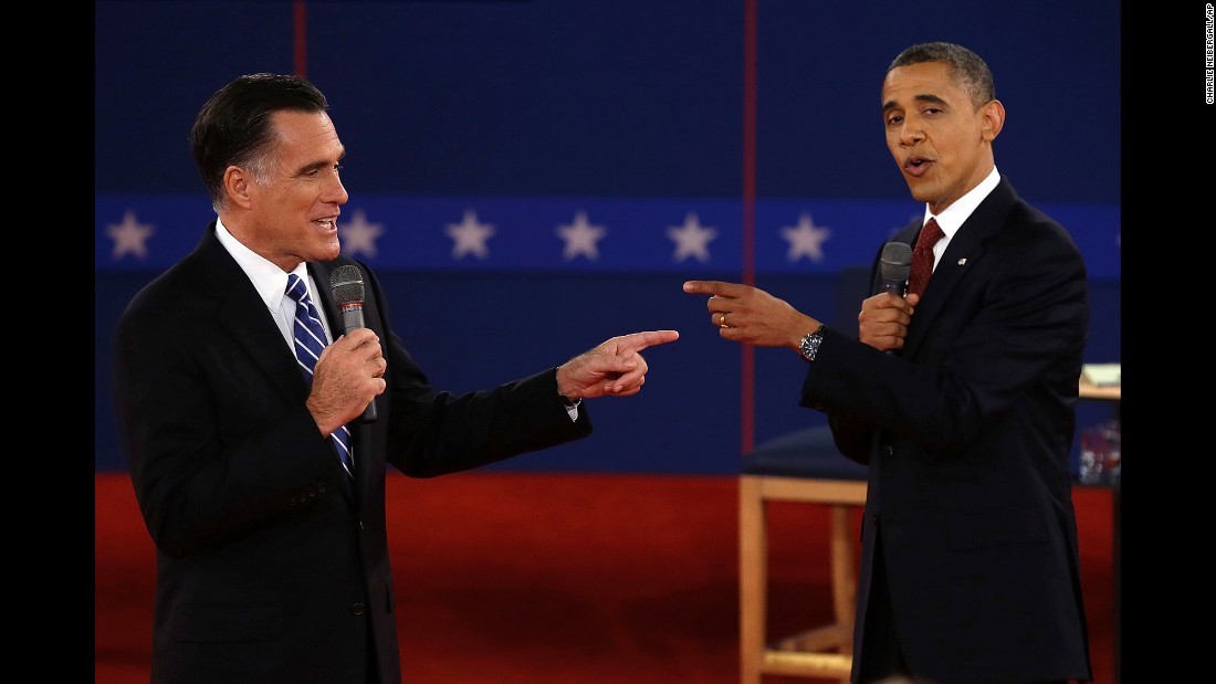 "Obama faces off with Mitt Romney at a presidential debate in Hempstead, New York, on October 16, 2012. Obama <a href=""http://www.cnn.com/2012/11/06/politics/election-2012/"" target=""_blank"">was re-elected</a> with 332 electoral votes to Romney's 206."