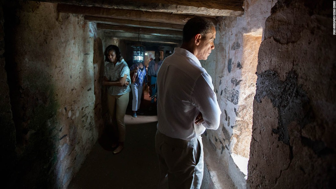 "Obama and the first lady tour an old slave house on Senegal's Goree Island on June 27, 2013. It was part of a <a href=""http://www.cnn.com/2013/06/28/politics/gallery/obama-in-africa/"" target=""_blank"">three-nation tour in Africa.</a> ""For an African-American -- and an African-American President -- to be able to visit this site, I think (it) gives me even greater motivation in terms of the defense of human rights around the world,"" Obama said."