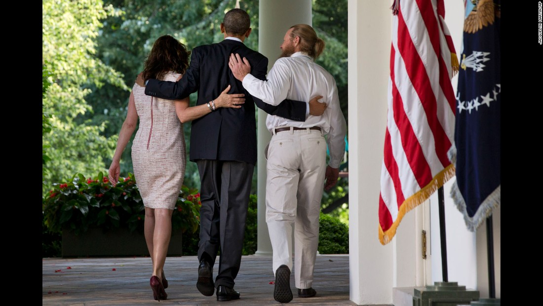 "Obama, center, walks with the parents of Army Sgt. Bowe Bergdahl after making a statement about <a href=""http://www.cnn.com/2014/05/31/world/asia/afghanistan-bergdahl-release/index.html"" target=""_blank"">Bergdahl's release</a> on May 31, 2014. Bergdahl had been held captive in Afghanistan for nearly five years, and the Taliban released him in exchange for five U.S.-held prisoners."