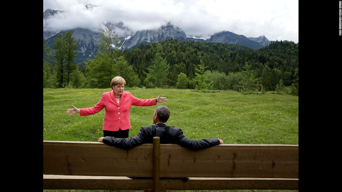 "German Chancellor Angela Merkel talks with Obama <a href=""http://www.cnn.com/2015/06/08/politics/barack-obama-angela-merkel-photo-germany-mountains/"" target=""_blank"">near the Bavarian Alps</a> on June 8, 2015. Obama and other world leaders were in Germany for the annual G-7 Summit. ""Merkel asked the leaders and outreach guests to make their way to a bench for a group photograph,"" White House Photographer Pete Souza said. ""The President happened to sit down first, followed closely by the Chancellor. I only had time to make a couple of frames before the background was cluttered with other people."""