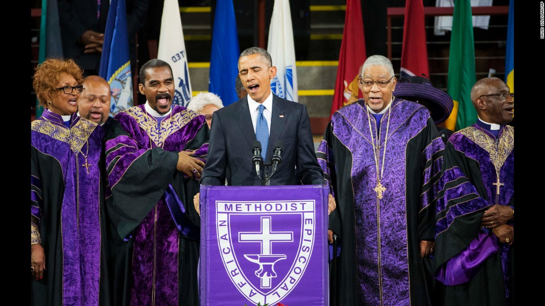 "Obama sings ""Amazing Grace"" during services honoring the life of South Carolina state Sen. Clementa Pinckney on June 26, 2015. Pinckney was one of nine people <a href=""http://www.cnn.com/2015/06/24/us/charleston-church-shooting-main/"" target=""_blank"">killed in a church shooting</a> in Charleston, South Carolina."