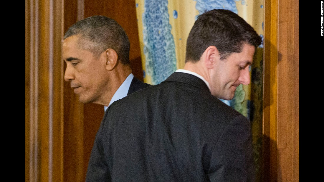 Obama walks past House Speaker Paul Ryan in Washington during a St. Patrick's Day lunch with Irish Prime Minister Enda Kenny on March 15, 2016.