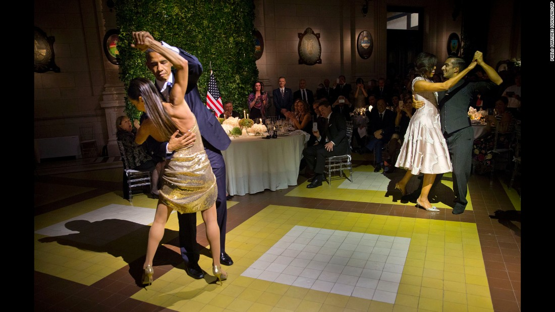 Obama, left, and first lady Michelle Obama, right, tango with dancers during a state dinner in Buenos Aires on March 23, 2016.