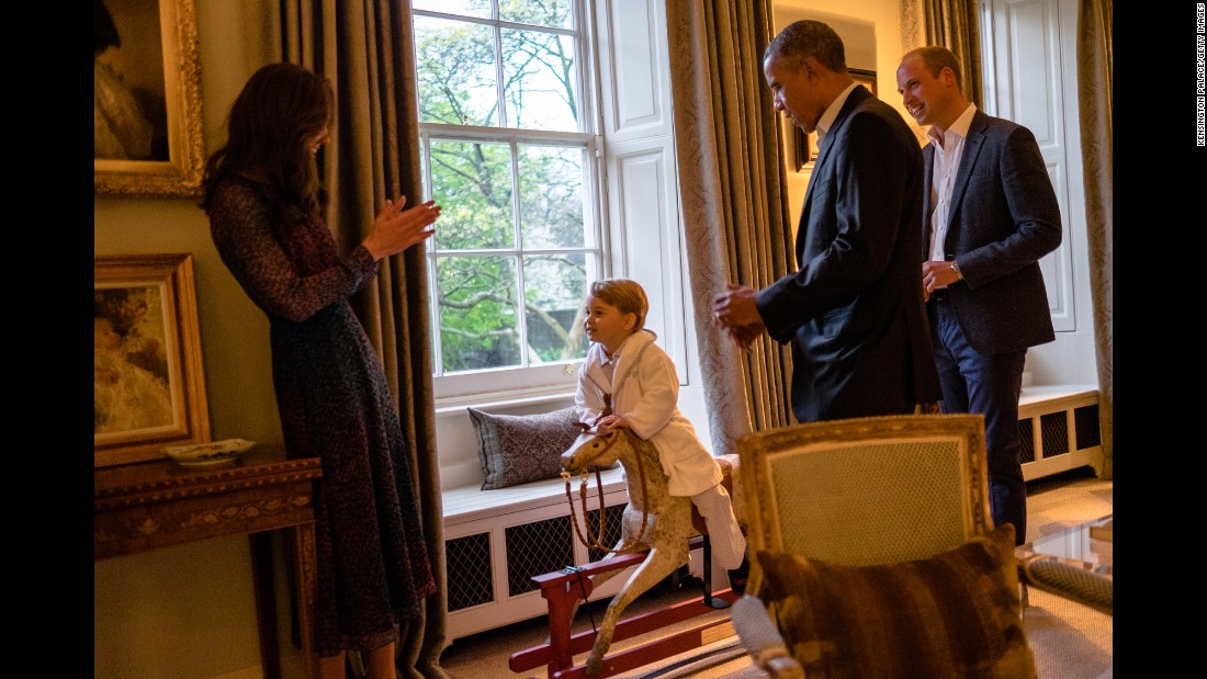 "Obama talks with Britain's Prince William, right, as William's wife Catherine, the Duchess of Cambridge, plays with their son, Prince George, on April 22, 2016. The President and his wife <a href=""http://www.cnn.com/2016/04/18/politics/gallery/obamas-meet-royals/index.html"" target=""_blank"">were visiting Kensington Palace</a> in London."