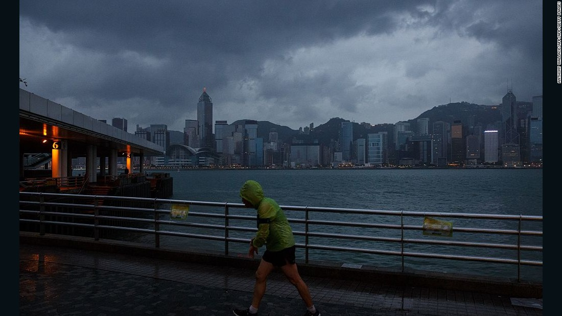 A runner braves the weather shortly after the T8 typhoon warning signal was raised.