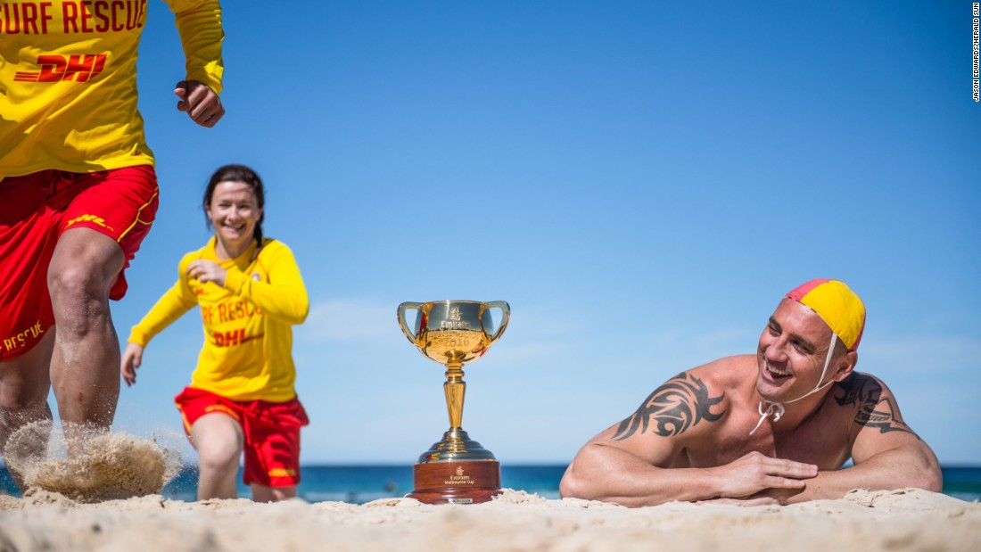 Surf lifesaver Luke Wilson with the Cup on the famous Bondi Beach in Sydney, New South Wales.