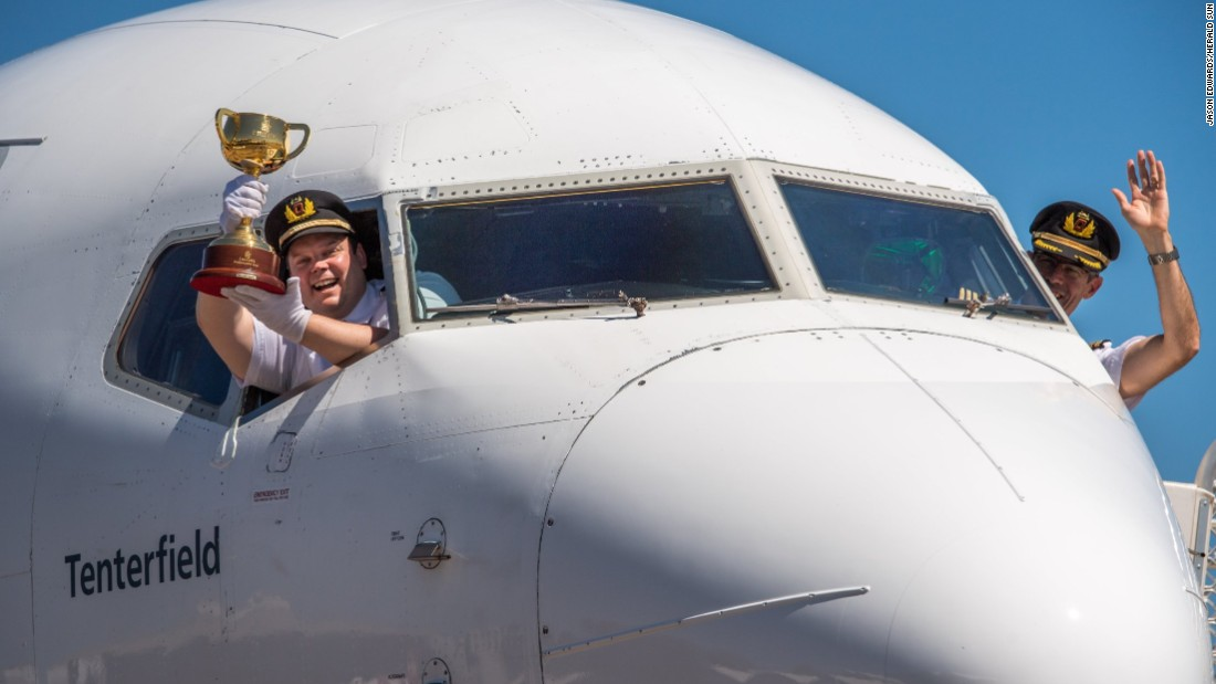 Pilots on board a flight from Perth to Broome before the trophy embarks on the next leg of its journey.