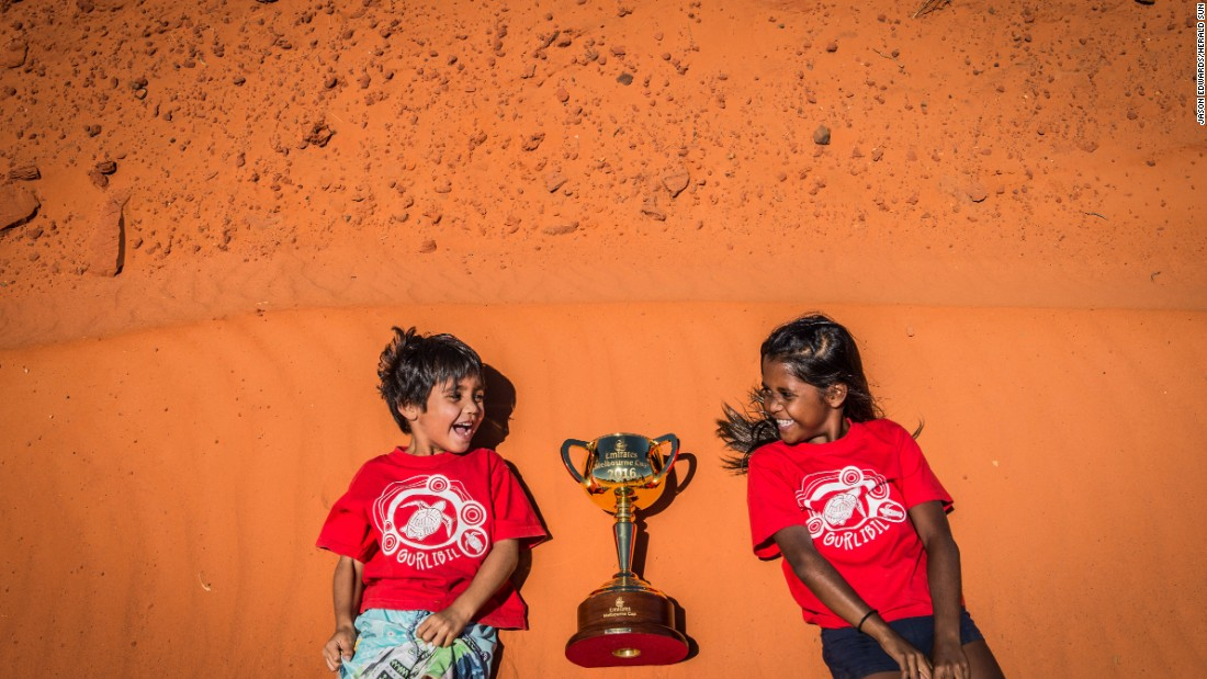 Siblings Dominic (aged five) and Zuleeyah (aged eight) Treacy with the 2016 Emirates Melbourne Cup at Gantheaume Point in Broome, Western Austria.